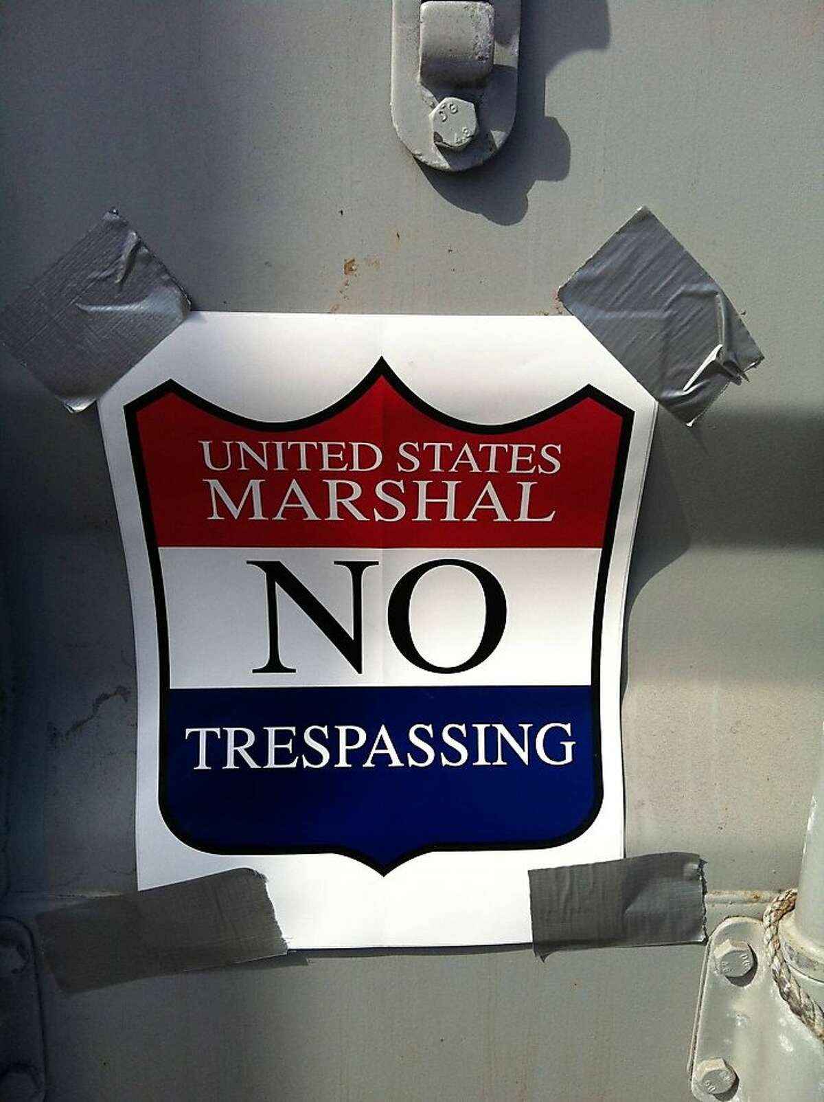 A U.S. Marshal sign placed on the shipping container holding the Energy Team French America's Cup boat.