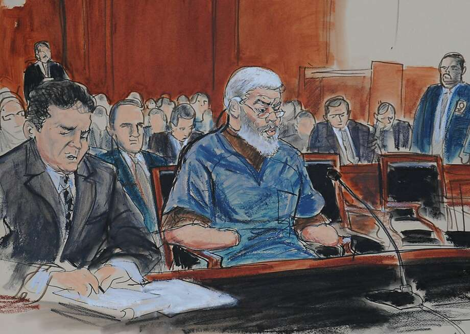 In this courtroom drawing, defense attorney, Jeremy Schneider, left, represents accused terrorist Abu Hamza al-Masri, center, in Manhattan federal court, Tuesday, Oct. 9, 2012, in New York. (AP Photo/ Elizabeth Williams) Photo: Elizabeth Williams, Associated Press