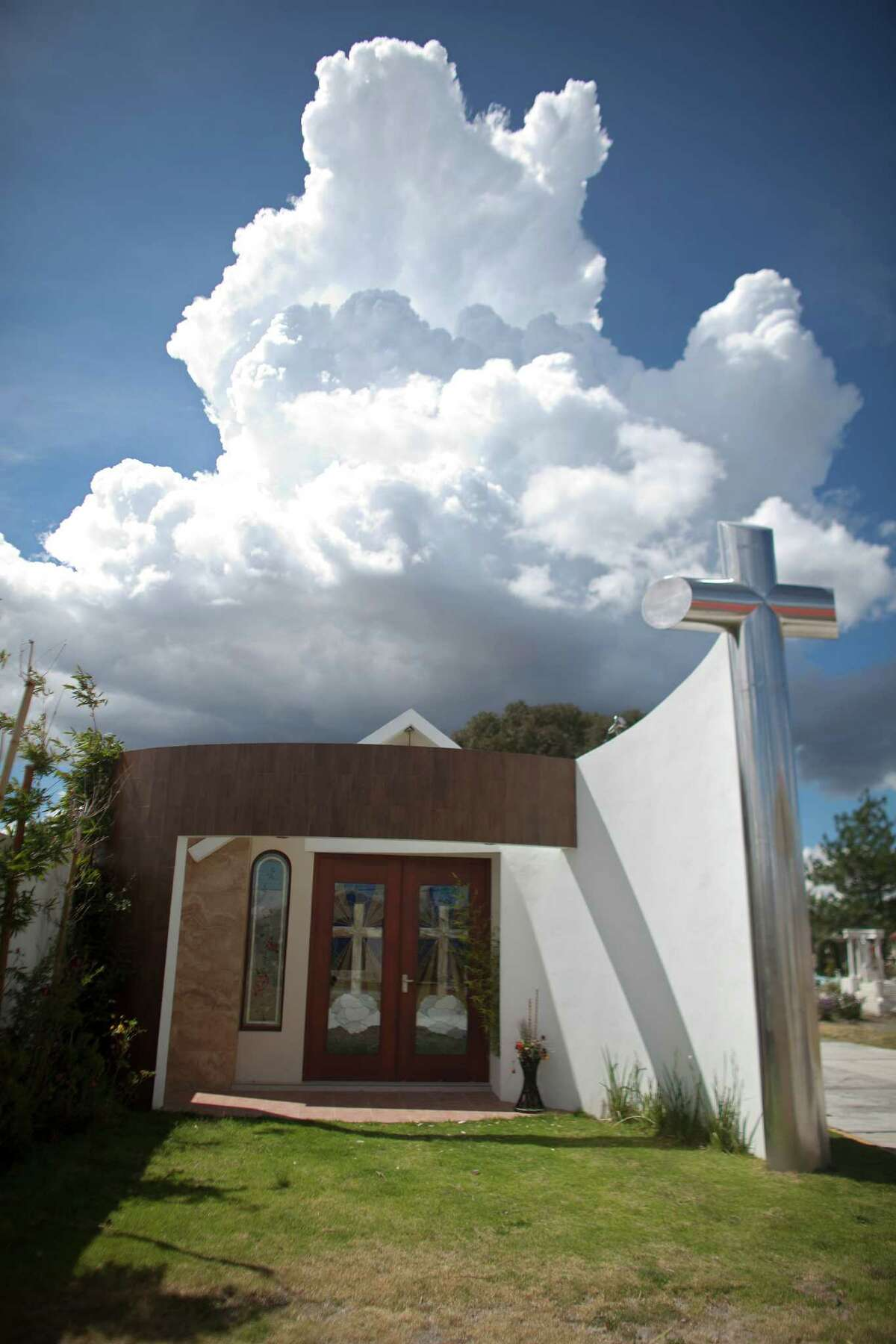 A tomb that was allegedly built by Heriberto Lazcano Lazcano, leader of the Zetas, stands at a cemetery in the neighborhood of Tezontle in Pachuca, Mexico, Tuesday, Oct. 9, 2012. The tomb is a small scale copy of a church in Tezontle, which at one point had a plaque naming Lazcano as the donor. Mexico's Navy says fingerprints confirm that cartel leader Lazcano, an army special forces deserter, was killed Sunday, Oct. 7, 2012 in a firefight with marines in the northern state of Coahuila on the border with the Texas. (AP Photo/Alexandre Meneghini)