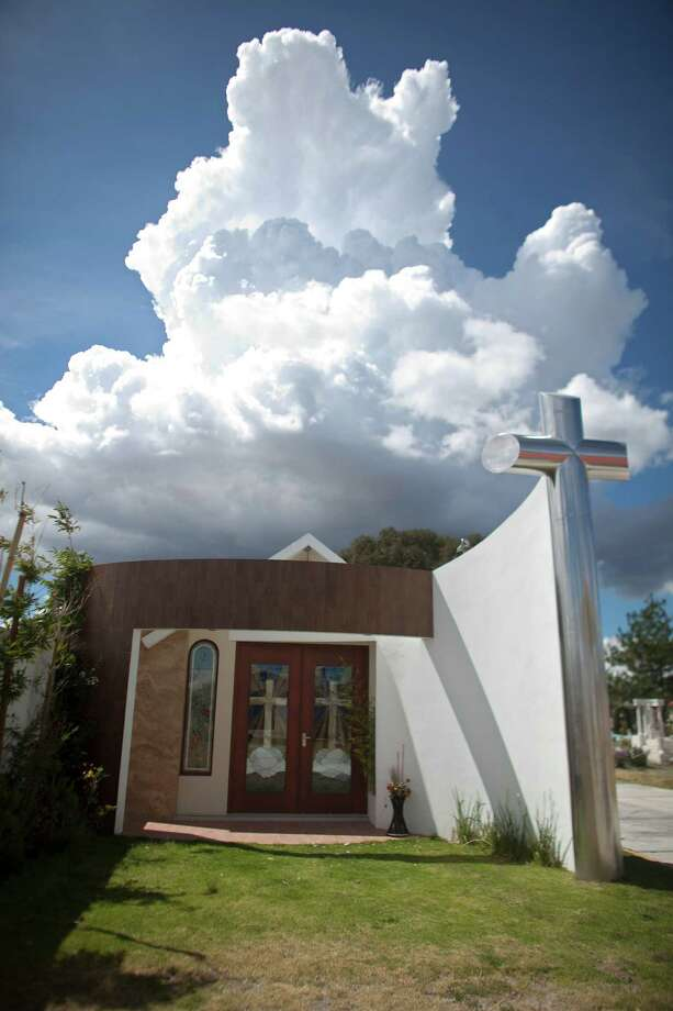 A tomb that was allegedly built by Heriberto Lazcano Lazcano, leader of the Zetas, stands at a cemetery in the neighborhood of Tezontle in Pachuca, Mexico, Tuesday, Oct. 9, 2012. The tomb is a small scale copy of a church in Tezontle, which at one point had a plaque naming Lazcano as the donor. Mexico's Navy says fingerprints confirm that cartel leader Lazcano, an army special forces deserter, was killed Sunday, Oct. 7, 2012 in a firefight with marines in the northern state of Coahuila on the border with the Texas. (AP Photo/Alexandre Meneghini) Photo: Alexandre Meneghini, Associated Press / AP