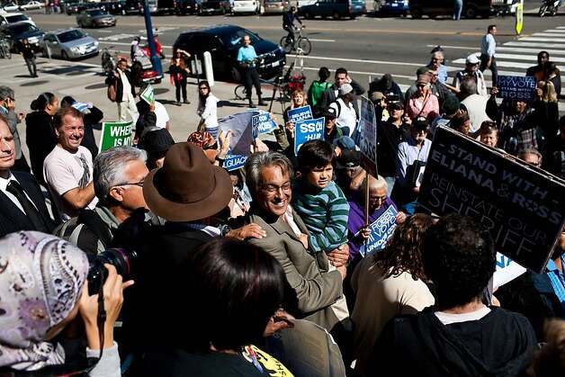 Suspended Sheriff Ross Mirkarimi holds his son, Theo, during a rally on the steps of San Francisco's City Hall before his hearing with the supervisors, who vote 4-11 to reinstate him. Photo: Jason Henry, Special To The Chronicle