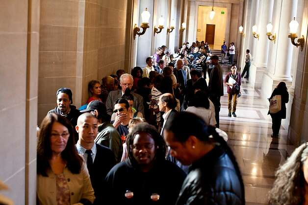 The public lines up to get the hearing room inside City Hall before Mirkarimi's hearing with the Board of Supervisors in San Francisco, Calif., Tuesday, October 9, 2012. Photo: Jason Henry, Special To The Chronicle
