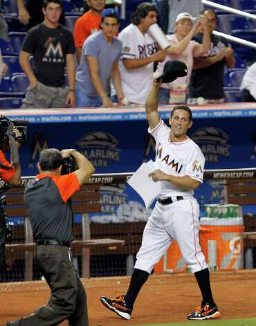 Miami Marlins' Adam Greenberg acknowledges the fans after the Marlins won 4-3 against the New York Mets in 11 innings of a baseball game in Miami, Tuesday, Oct. 2, 2012. Greenberg struck out on three pitches against Mets R.A. Dickey when he batted for the first time in seven years in the sixth inning. Greenberg signed a one-day contract before the game, his first since he was beaned in his major league debut in 2005. (AP Photo/Alan Diaz) Photo: Alan Diaz, Associated Press / AP