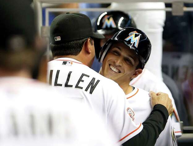 MIAMI, FL - OCTOBER 02:  Adam Greenberg #10 of the Miami Marlins hugs manager Ozzie Guillen #13 after striking out against the New York Mets at Marlins Park on October 2, 2012 in Miami, Florida. Greenberg was batting for the first time since being hit in the head by a pitch in 2005 in his first Major Leauge at-bat.  (Photo by Marc Serota/Getty Images)  *** BESTPIX *** Photo: Marc Serota, Getty Images / 2012 Getty Images