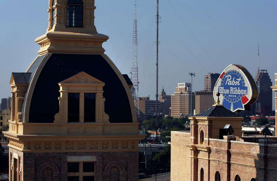 A Pabst Blue Ribbon sign can be seen from the smokestack at the Pearl Brewery in 2008. John Davenport / San Antonio Express-News Photo: JOHN DAVENPORT, - / jdavenport@express-news.net