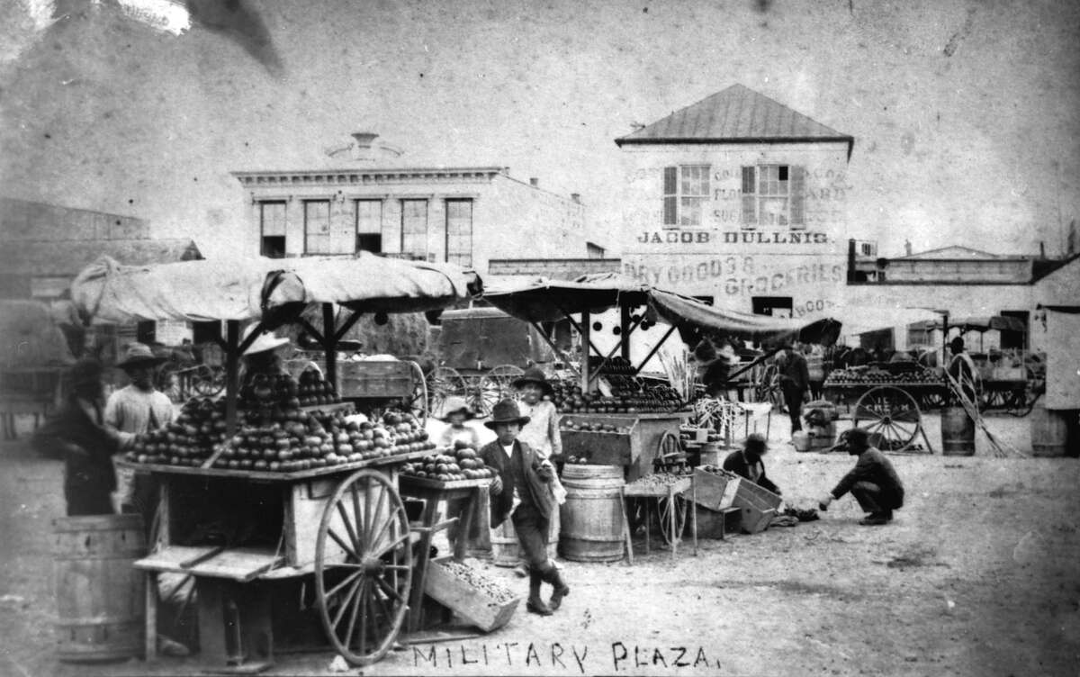 Produce vendors gather in Military Plaza in 1883. The need to make room on the plaza for the construction of a new City Hall in 1890 caused the market to moved west to Market Square.