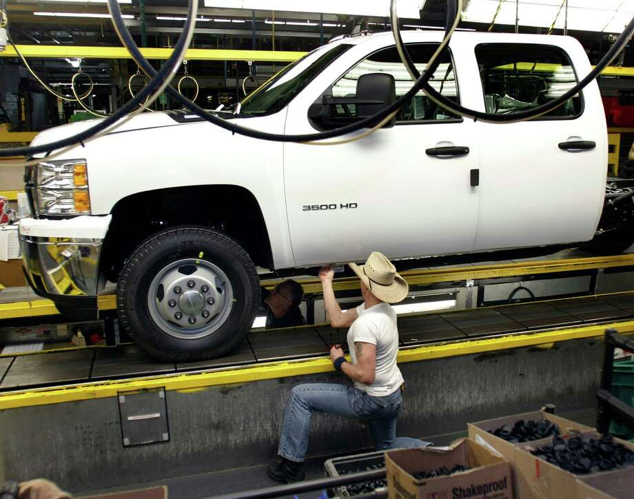Another white Chevrolet pickup truck moves along the assembly line of the General Motors Flint (Mich.) Assembly Plant. One in four U.S. pickups is white because many trucks are bought for use by businesses. Photo: Bill Pugliano / 2011 Getty Images