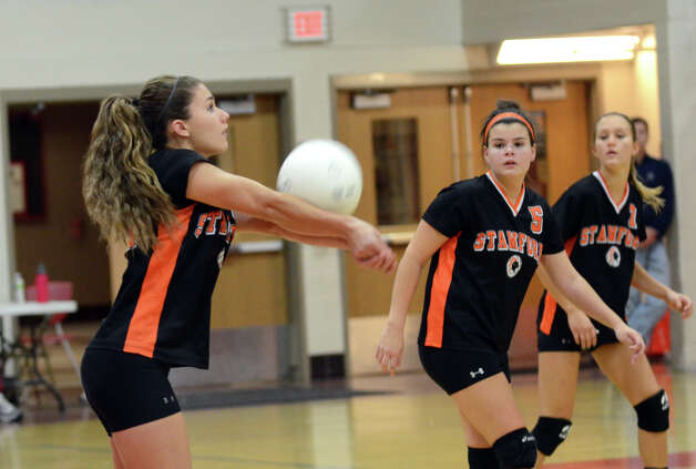 Stamford's Nicole Pease (23) hits the ball during the girls volleyball game against New Canaan at New Canaan High School on Tuesday, Oct. 9, 2012. Photo: Amy Mortensen / Connecticut Post Freelance