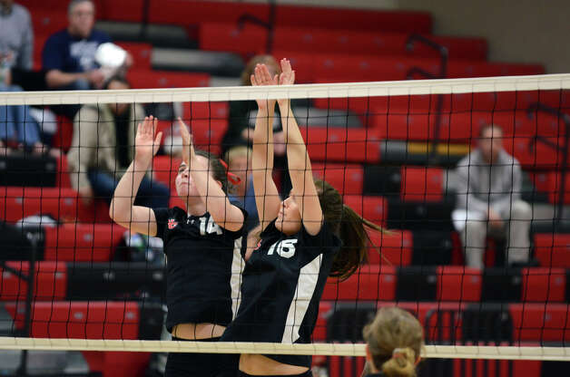 New Canaan's Madison Mulhern (14) and Samantha Moffatt (16) protect the net during the girls volleyball game against Stamford at New Canaan High School on Tuesday, Oct. 9, 2012. Photo: Amy Mortensen / Connecticut Post Freelance