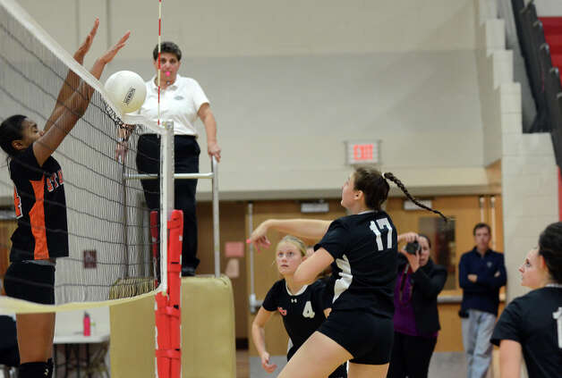New Canaan's Isabelle Herde (17) gets a shot past Stamford's Brianna Gordon (14) during the girls volleyball game at New Canaan High School on Tuesday, Oct. 9, 2012. Photo: Amy Mortensen / Connecticut Post Freelance