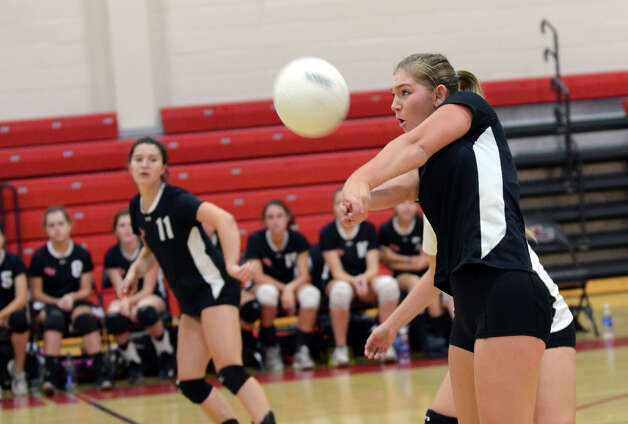 New Canaan's Emma Stracke (10) hits the ball during the girls volleyball game against Stamford at New Canaan High School on Tuesday, Oct. 9, 2012. Photo: Amy Mortensen / Connecticut Post Freelance