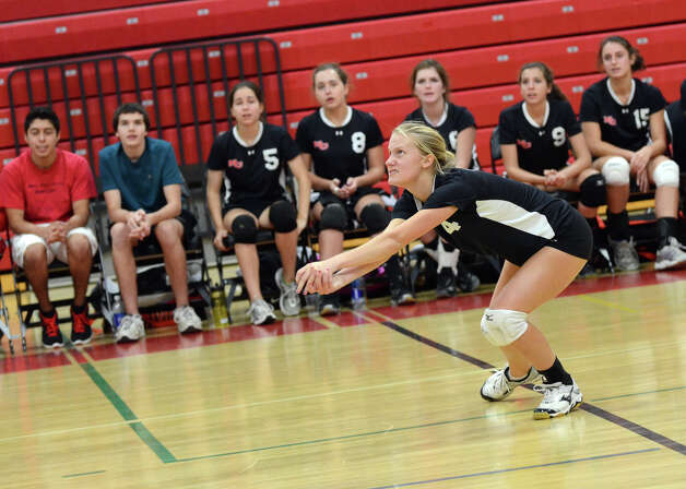 New Canaan's Joanna Baran (4) tracks her hit during the girls volleyball game against Stamford at New Canaan High School on Tuesday, Oct. 9, 2012. Photo: Amy Mortensen / Connecticut Post Freelance