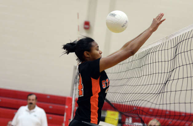 A shot gets past Stamford's Brianna Gordon (14) during the girls volleyball game against New Canaan at New Canaan High School on Tuesday, Oct. 9, 2012. Photo: Amy Mortensen / Connecticut Post Freelance
