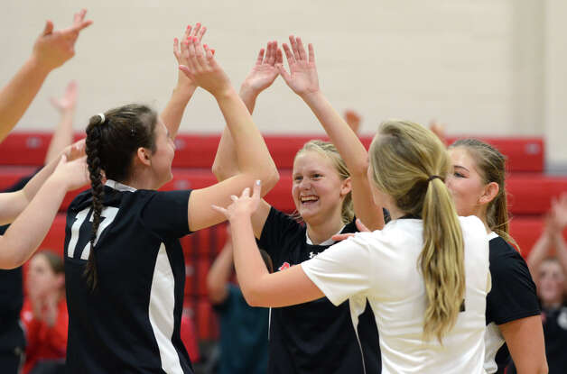 New Canaan's Joanna Baran (4) celebrates a point with teammates during the girls volleyball game against Stamford at New Canaan High School on Tuesday, Oct. 9, 2012. Photo: Amy Mortensen / Connecticut Post Freelance
