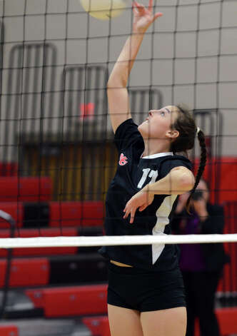 New Canaan's Isabelle Herde (17) hits the ball during the girls volleyball game against Stamford at New Canaan High School on Tuesday, Oct. 9, 2012. Photo: Amy Mortensen / Connecticut Post Freelance