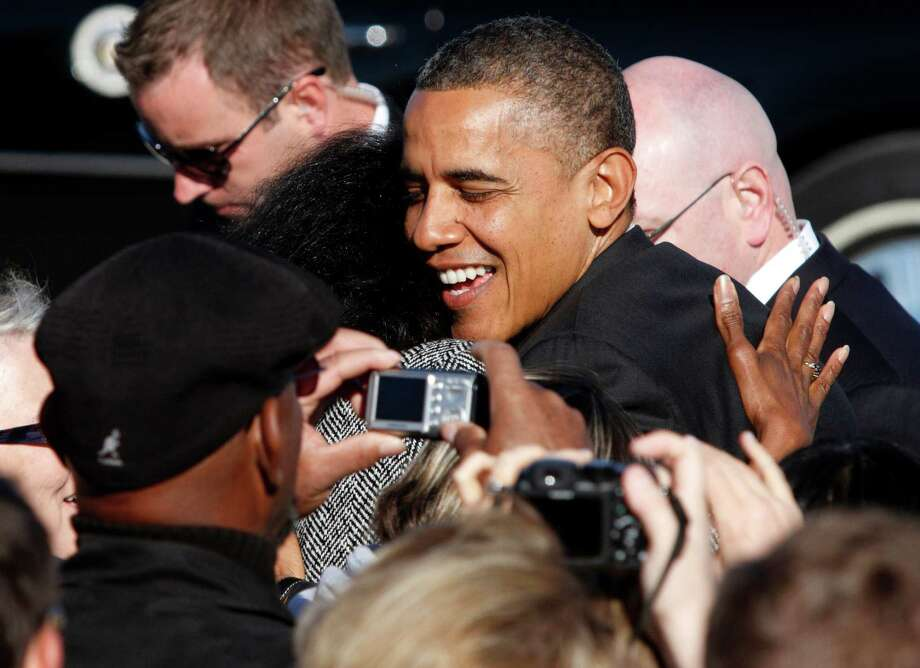 President Barack Obama hugs a supporter at Rickenbacker International Airport in Columbus, Ohio. Photo: Paul Vernon / FR66830 AP