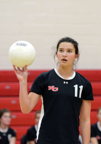 New Canaan's Annie Conover (11) during the girls volleyball game against Stamford at New Canaan High School on Tuesday, Oct. 9, 2012. Photo: Amy Mortensen / Connecticut Post Freelance