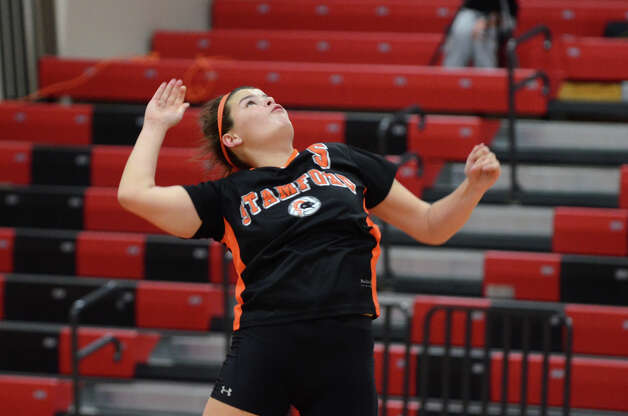 Stamford's Greta Buckley (5) serves during the girls volleyball game against New Canaan at New Canaan High School on Tuesday, Oct. 9, 2012. Photo: Amy Mortensen / Connecticut Post Freelance