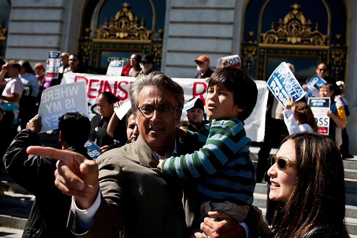 Former Sheriff Ross Mirkarimi, with wife and son, attends a rally on the steps of City Hall before his hearing with the Board of Supervisors in San Francisco, Calif., Tuesday, October 9, 2012.