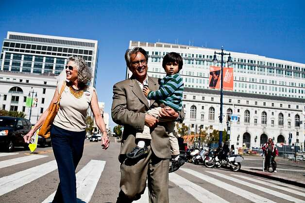 Former Sheriff Ross Mirkarimi, holding his son, attends a rally on the steps of City Hall before his hearing with the Board of Supervisors in San Francisco, Calif., Tuesday, October 9, 2012. Photo: Jason Henry, Special To The Chronicle