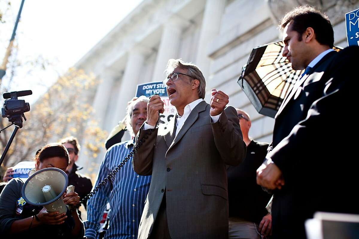 Former Sheriff Ross Mirkarimi attends addresses supporters at a rally on the steps of City Hall before his hearing with the Board of Supervisors in San Francisco, Calif., Tuesday, October 9, 2012.