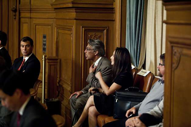 Ross Mirkarimi, with wife Eliana Lopez, in the chamber of the board of supervisors before his hearing at City Hall in San Francisco, Calif., Tuesday, October 9, 2012. Photo: Jason Henry, Special To The Chronicle