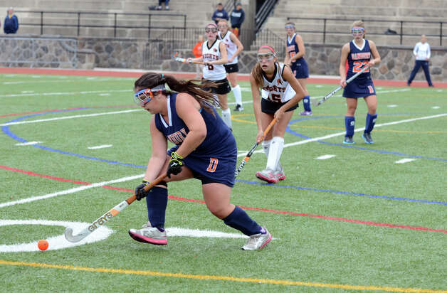Danbury's Christie Colucci (15) controls the ball during the field hockey game against Stamford at Stamford High School on Tuesday, Oct. 9, 2012. Photo: Amy Mortensen / Connecticut Post Freelance