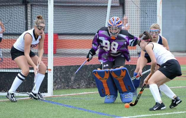 Danbury's goalie Kristy Trotta (98) defends against Stamford's Lindsey Colondro (6) during the field hockey game at Stamford High School on Tuesday, Oct. 9, 2012. Photo: Amy Mortensen / Connecticut Post Freelance