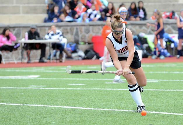 Stamford's Sam Jaykus (8) controls the ball during the field hockey game against Danbury at Stamford High School on Tuesday, Oct. 9, 2012. Photo: Amy Mortensen / Connecticut Post Freelance