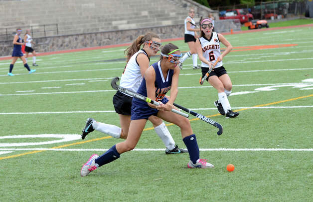 Danbury's Jen Bichof (2) controls the ball as Stamford's Sarah Abruzzini (4) defends during the field hockey game at Stamford High School on Tuesday, Oct. 9, 2012. Photo: Amy Mortensen / Connecticut Post Freelance