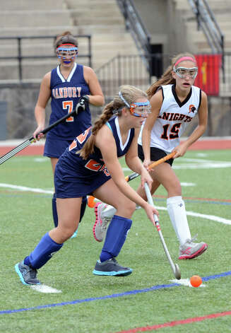 Danbury's Mary Zanine (22) controls the ball as Stamford's Brianna Longo (15) defends during the field hockey game at Stamford High School on Tuesday, Oct. 9, 2012. Photo: Amy Mortensen / Connecticut Post Freelance