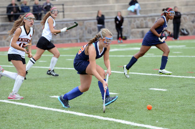 Danbury's Mary Zanine (22) controls the ball during the field hockey game against Stamford at Stamford High School on Tuesday, Oct. 9, 2012. Photo: Amy Mortensen / Connecticut Post Freelance