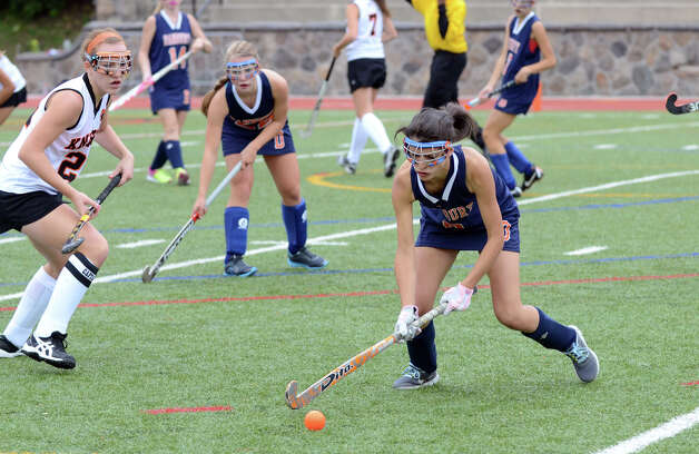 Danbury's Emily Saba (8) controls the ball during the field hockey game against Stamford at Stamford High School on Tuesday, Oct. 9, 2012. Photo: Amy Mortensen / Connecticut Post Freelance