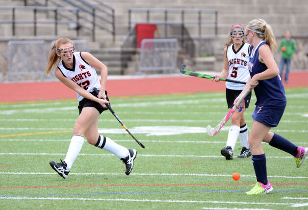 Stamford's Taylor Mills (22) passes the ball during the field hockey game against Danbury at Stamford High School on Tuesday, Oct. 9, 2012. Photo: Amy Mortensen / Connecticut Post Freelance