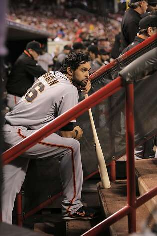Giants' Angel Pagan watches from the dugout in the fourth inning, as the San Francisco Giants take on the Cincinnati Reds in game three of the National League Division Series in Cincinnati, Ohio on Tuesday Oct. 9, 2012. Photo: Michael Macor, The Chronicle
