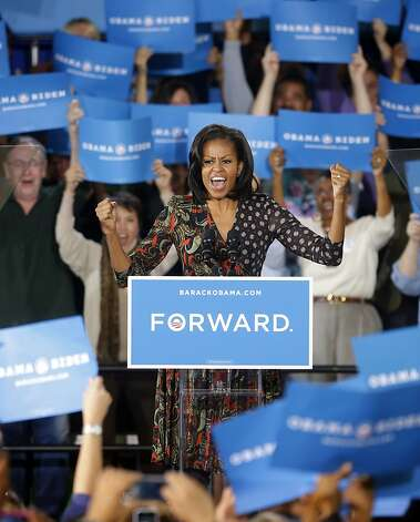 First lady Michelle Obama speaks to supporters during a campaign event at the Loudoun County Fairgrounds, Tuesday, Oct. 9, 2012, in Leesburg, Va.  Photo: Pablo Martinez Monsivais, Associated Press