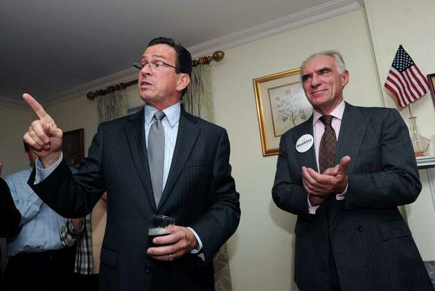 Connecticut Gov. Dannel P. Malloy points his finger during a campaign event for fellow Democrat John Blankley, right, at Blankley's Greenwich home, Tuesday night, Oct. 9, 2012. Blankley is running against Republican incumbent state Rep. Livvy Floren, for the 149th District seat. Photo: Bob Luckey / Greenwich Time