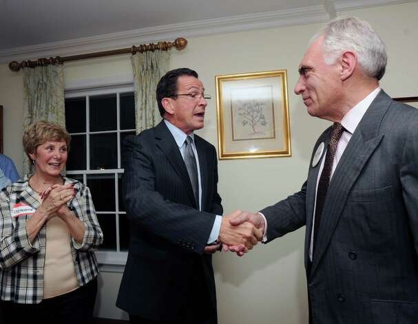At center, Connecticut Gov. Dannel P. Malloy shakes hands with Democrat John Blankley, right, at Blankley's Greenwich home, Tuesday night, Oct. 9, 2012. At left is Greenwich resident Stephanie Paulmeno who is running for state Rep. in the 150th district. Blankley is running against Republican incumbent state Rep. Livvy Floren, for the 149th District seat. Photo: Bob Luckey / Greenwich Time
