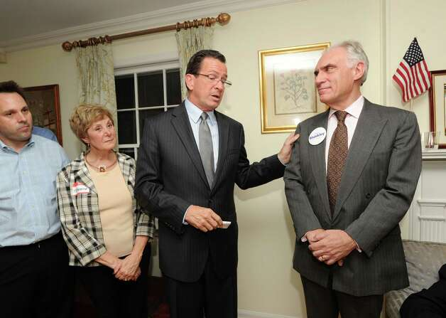 Connecticut Gov. Dannel P. Malloy puts a hand on the shoulder of Democrat John Blankley, right, at Blankley's Greenwich home, Tuesday night, Oct. 9, 2012. At left is Greenwich Selectman Drew Marzullo, second from left is Greenwich resident Stephanie Paulmeno who is running for state Rep. in the 150th district. Blankley is running against Republican incumbent state Rep. Livvy Floren, for the 149th District seat. Photo: Bob Luckey / Greenwich Time