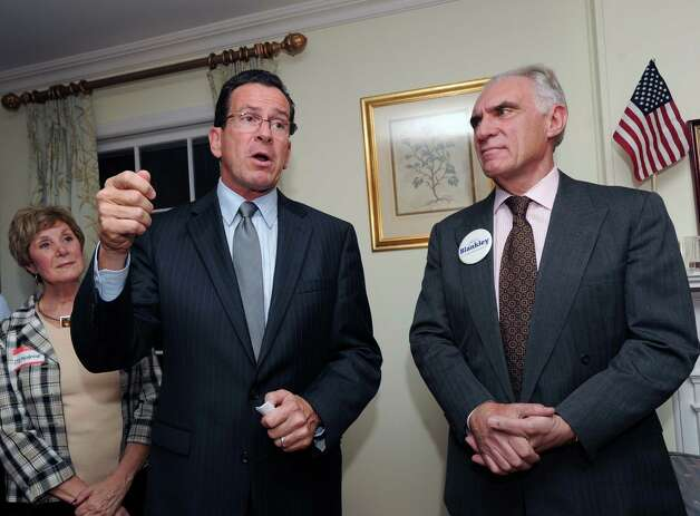 At center, Connecticut Gov. Dannel P. Malloy speaks during a campaign event for fellow Democrat John Blankley, right, at Blankley's Greenwich home, Tuesday night, Oct. 9, 2012. At left is Greenwich resident Stephanie Paulmeno who is running for state Rep. in the 150th district. Blankley is running against Republican incumbent state Rep. Livvy Floren, for the 149th District seat. Photo: Bob Luckey / Greenwich Time
