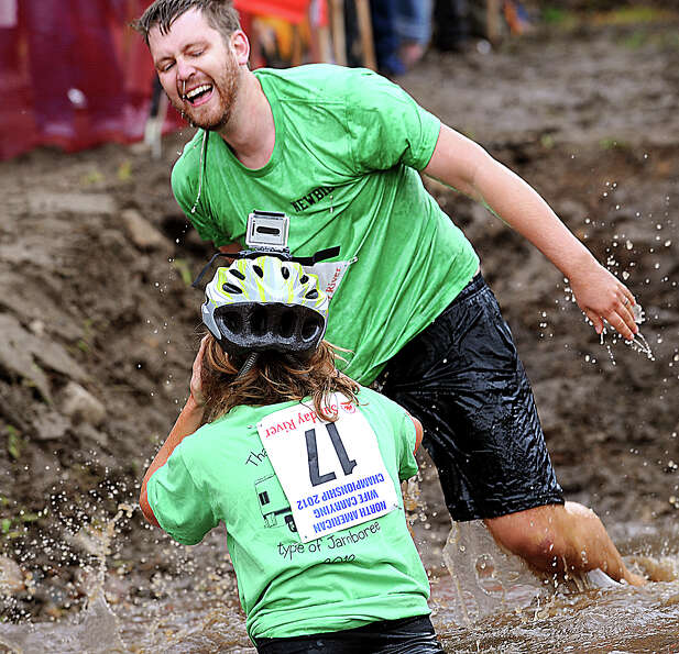 Arthur and Jenna Aery come up laughing despite taking a fall in the water hazard during at the 2012