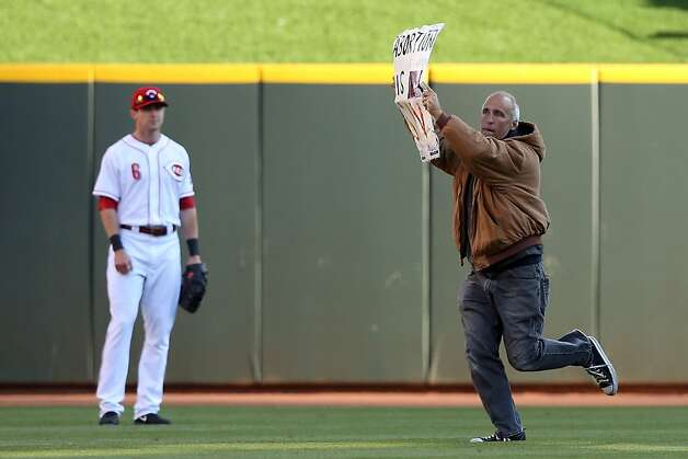 CINCINNATI, OH - OCTOBER 09:  A man runs onto the field holding a sign saying 'Abortion is Sin' before the Cincinnati Reds take on the San Francisco Giants in Game Three of the National League Division Series at the Great American Ball Park on October 9, 2012 in Cincinnati, Ohio.  (Photo by Andy Lyons/Getty Images) Photo: Andy Lyons, Getty Images