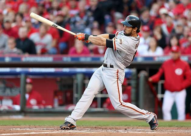 CINCINNATI, OH - OCTOBER 09:  Angel Pagan #16 of the San Francisco Giants hits a sacrifice fly to score Gregor Blanco #7 in the third inning against the Cincinnati Reds in Game Three of the National League Division Series at the Great American Ball Park on October 9, 2012 in Cincinnati, Ohio.  (Photo by Andy Lyons/Getty Images) Photo: Andy Lyons, Getty Images