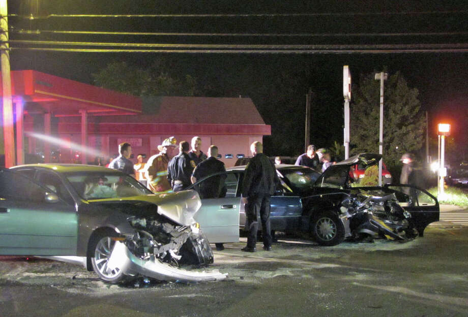 Three people were hospitalized after a head-on collision between two cars on Stratford Avenue near Beardsley Avenue in Stratford, Conn. on Tuesday night, Oct. 9, 2012. Photo: Tom Cleary