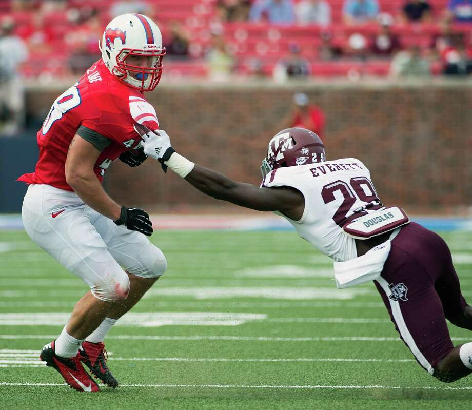 A&M defensive back Deshazor Everett (right), defending SMU running back Zach Line, is considered small at 181 pounds. Photo: Smiley N. Pool, Houston Chronicle / © 2012  Houston Chronicle