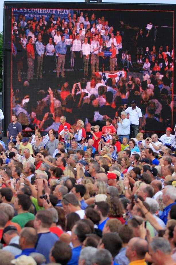WAUKESHA, WI - AUGUST 12: Supporters listen as Republican presidential candidate and former Massachusetts Gov. Mitt Romney and vice presidential candidate and Wisconsin native Rep. Paul Ryan (R-WI) speak during a campaign event at the Waukesha Expo Center on August 12, 2012 in Waukesha, Wisconsin. Romney continues his four day bus tour a day after announcing his running mate, Rep. Paul Ryan. (Photo by Darren Hauck/Getty Images) (Darren Hauck / Getty Images)