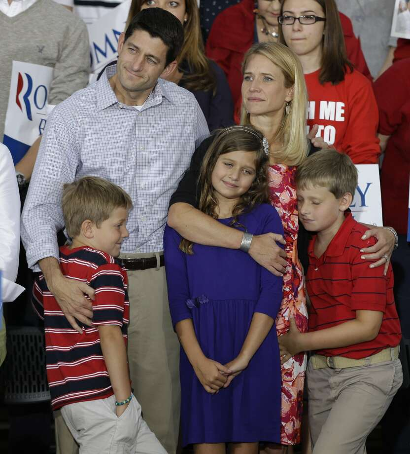Vice presidential running mate Rep. Paul Ryan, R-Wis,left,  his wife Janna and daughter Liza and sons Charles, and Sam, right, during a welcome home rally Sunday, August, 12, 2012 in Waukesha, Wis. (AP Photo/Jeffrey Phelps) (JEFFREY PHELPS / Associated Press)