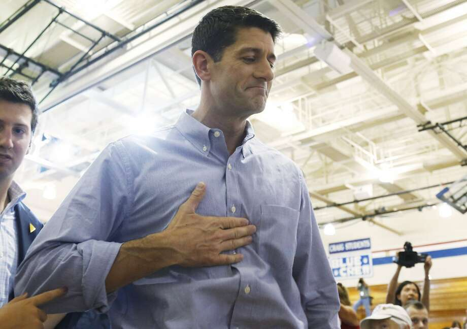 "JANESVILLE, WI - AUGUST 27:  The presumptive vice presidential candidate U.S. Rep. Paul Ryan (R-WI) greets people during a ""Send-Off"" rally August, 27, 2012 in Janesville, Wisconsin. Ryan and presumptive presidential candidate and former Massachusetts Gov. Mitt Romney will be on their way to Tampa, Florida for the Republican National Convention. The convention was gaveled open August 27 and immediately recessed until tomorrow because of Tropical Storm Isaac.  (Photo by Jeffrey Phelps/Getty Images) (Jeffrey Phelps / Getty Images)"