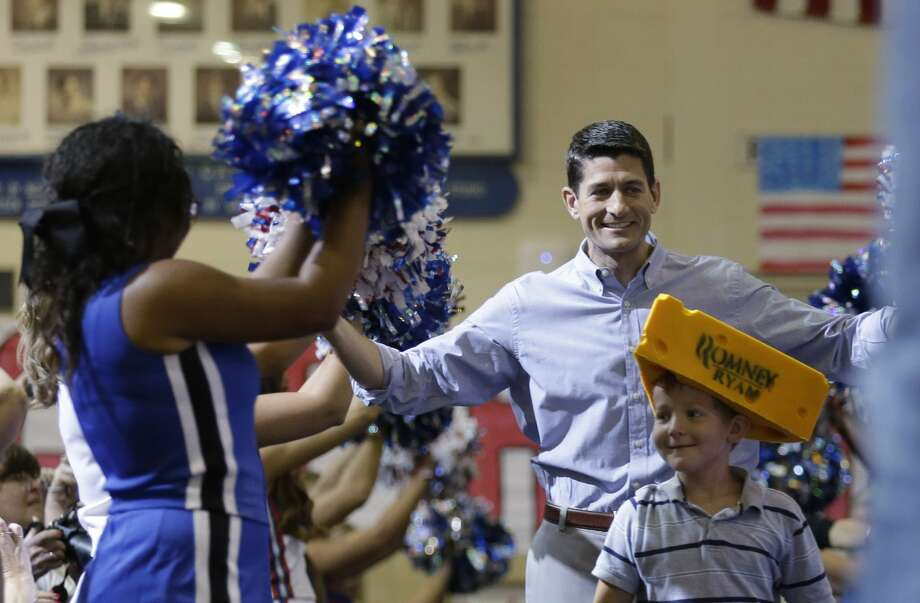 "JANESVILLE, WI - AUGUST 27:  The presumptive vice presidential candidate U.S. Rep. Paul Ryan (R-WI) arrives during a ""Send-off"" rally August, 27, 2012 in Janesville, Wisconsin. Ryan and presumptive presidential candidate and former Massachusetts Gov. Mitt Romney will be on their way to Tampa, Florida for the Republican National Covent ion. The convention was gaveled open August 27 and immediately recessed until tomorrow because of Tropical Storm Isaac.  (Photo by Jeffrey Phelps/Getty Images) (Jeffrey Phelps / Getty Images)"