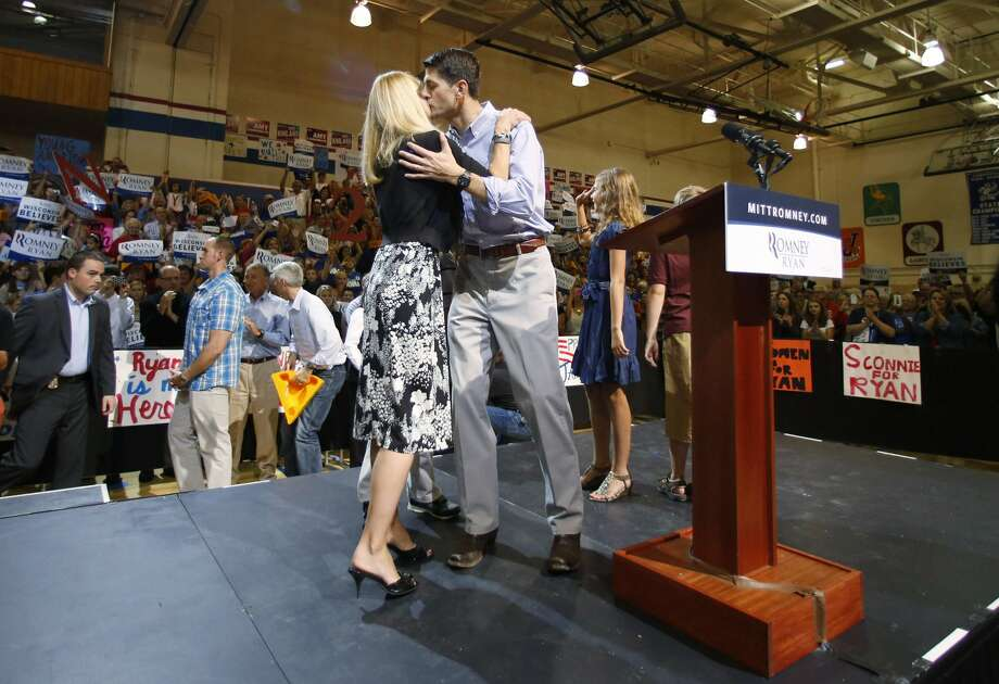 "JANESVILLE, WI - AUGUST 27:   Presumptive vice presidential candidate U.S. Rep. Paul Ryan (R-WI) (R) kisses his wife Janna Ryan during a ""Send-Off"" rally August, 27, 2012 in Janesville, Wisconsin. Ryan and presumptive presidential candidate and former Massachusetts Gov. Mitt Romney will be on their way to Tampa, Florida for the Republican National Convention. The convention was gaveled open August 27 and immediately recessed until tomorrow because of Tropical Storm Isaac.  (Photo by Jeffrey Phelps/Getty Images)   *** BESTPIX *** (Jeffrey Phelps / Getty Images)"